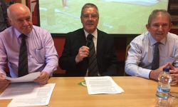 Chairman Roger Davies opens the AGM, flanked by Peter Howells and Steve Reardon